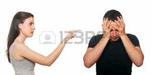 Unhappy young couple having an argument. Isolated on white. Stock Photo - 14025650